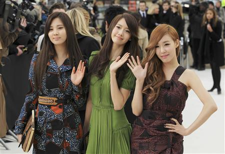 Girls' Generation singers (L - R) Seohyun, Yoona and Tiffany arrive at the Burberry 2012 Autumn/Winter womenswear collection show during London Fashion Week in London February 20, 2012. REUTERS/Olivia Harris