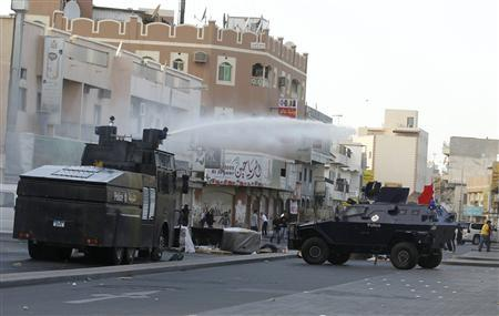 Police spray water at anti-government protesters in the village of Jidhafs, west of Manama, February 20, 2012. REUTERS/Hamad I Mohammed