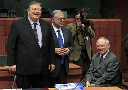 (L to R) Greece's Finance Minister Evangelos Venizelos, Greece's Prime Minister Lucas Papademos and Germany's Finance Minister Wolfgang Schaeuble attend a Eurogroup meeting at the European Union council headquarters in Brussels February 20, 2012. REUTERS/Yves Herman