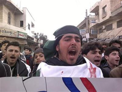 Demonstrators shout during a protest against Syria's President Bashar al-Assad, in Kafranbel near Idlib February 19, 2012. REUTERS/Handout