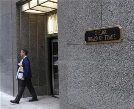 A trader walks out of the CME group at the Chicago Board of Trade in Chicago, February 11, 2011. REUTERS/Frank Polich