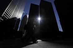 Two men walk down the street from the King and Bay intersection in the financial district in Toronto February 22, 2011.    REUTERS/Mark Blinch