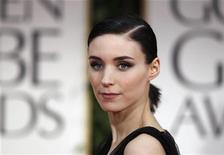 "Actress Rooney Mara, from the film ""The Girl with the Dragon Tattoo"", arrives at the 69th annual Golden Globe Awards in Beverly Hills, California January 15, 2012. REUTERS/Danny Moloshok"