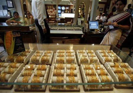 Gold jewellery is on display at a jewellery showroom in Kolkata March 6, 2008. REUTERS/Parth Sanyal/Files