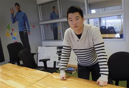 Tim Chae poses for a photo in a conference room where he attends ''500 Startups,'' a crash course for young companies run by a funding firm of the same name, in Mountain View February 16, 2012. Chae, 20, a Babson College dropout, has raised a small amount of capital for his company, Post Rocket, is seeking more and is hoping the upcoming Facebook IPO will help investors look more kindly on all young entrepreneurs. Photo taken February 16, 2012.  REUTERS/Robert Galbraith