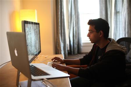 Sahil Lavingia, 19, chief executive officer (CEO) of Gumroad, an online payments company he started, works in his home which doubles as his office in the SOMA neighborhood of San Francisco February 17, 2012. Lavingia, who was born in New York and grew up in places like London, Hong Kong and Singapore, dropped out of the University of Southern California to work at online bulletin board company Pinterest. He also developed the Turntable.fm app for the iPhone.   REUTERS-Robert Galbraith