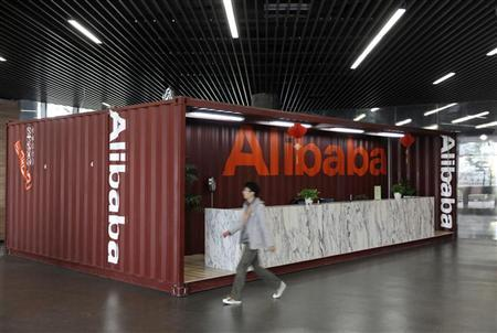 An employee walks inside the headquarters office of Alibaba (China) Technology Co. Ltd on the outskirts of Hangzhou, Zhejiang province March 16, 2010. REUTERS/Lang Lang
