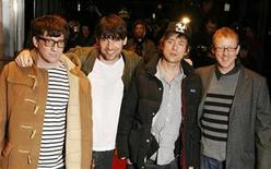 The members of Blur (L-R) Graham Coxon, Alex James, Damon Albarn and Dave Rowntree pose at Leicester Square in London, January 14, 2010.  