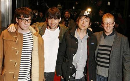 The members of Blur (L-R) Graham Coxon, Alex James, Damon Albarn and Dave Rowntree pose at Leicester Square in London, January 14, 2010.  REUTERS/Luke MacGregor