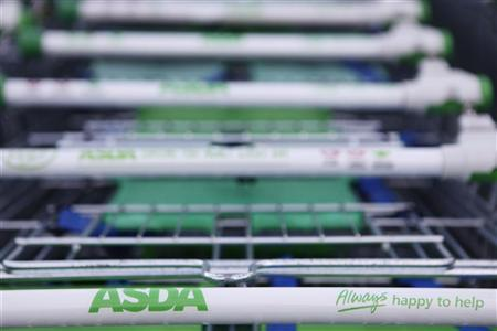 Trolleys are lined up outside an ASDA supermarket in London January 23, 2012. REUTERS/Finbarr O'Reilly