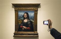 """A copy of Leonardo Da Vinci's famous """"Mona Lisa"""" painting is photographed after it was put on display at Madrid's El Prado Museum February 21, 2012.   REUTERS/Sergio Perez"""