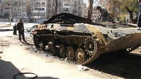 A damaged armoured vehicle belonging to the Syrian army is seen in the Syrian district of al-Khalidya in Homs February 20, 2012. REUTERS/Stringer