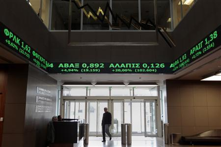 A man walks at the reception hall of the Athens Stock Exchange February 20, 2012. REUTERS/Yiorgos Karahalis