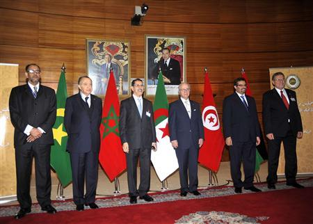 Members of the committee of the Arab Maghreb Union (UMA) pose for a picture during a meeting of the Monitoring Committee of UMA in Rabat February 18, 2012. REUTERS/Stringer