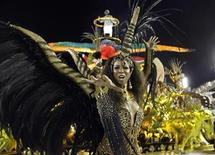 A reveller from the Grande Rio samba school takes part in the second night of the annual Carnival parade in Rio de Janeiro's Sambadrome February 21, 2012. REUTERS/Nacho Doce
