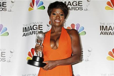 Actress Viola Davis poses with the Image Award she won as best actress in a motion picture for her role in ''The Help'' at the 43rd NAACP Image Awards in Los Angeles, California February 17, 2012. REUTERS/Fred Prouser