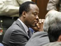 Dr. Conrad Murray closes his eyes after he was sentenced to four years in county jail for his involuntary manslaughter conviction of pop star Michael Jackson in Los Angeles November 29, 2011.   REUTERS/Mario Anzuoni