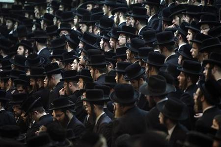 Ultra-Orthodox Jews attend a celebration for Tu Bishvat, the Jewish arbor day, at the Vizhnitz community main synagogue in Bnei Brak near Tel Aviv February 8, 2012. REUTERS/Nir Elias
