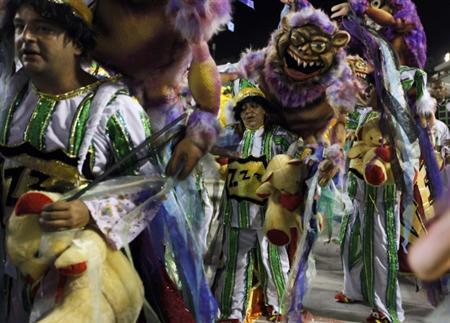Revellers from the Grande Rio samba school participate in the second night of the annual Carnival parade in Rio de Janeiro's Sambadrome February 21, 2012. REUTERS/Nacho Doce