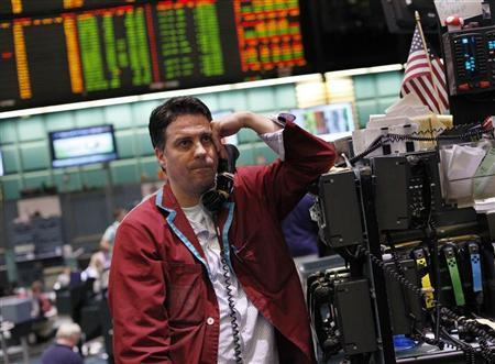 A trader works in the crude oil and natural gas options pit on the floor of the New York Mercantile Exchange in New York August 8, 2011. REUTERS/Shannon Stapleton