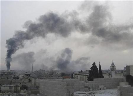Smoke is seen rising from Bab Amro near Homs February 15, 2012. REUTERS/Handout
