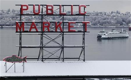 Snow blankets the roof of the famous Pike Place Market in Seattle, January 15, 2012. REUTERS/Anthony Bolante