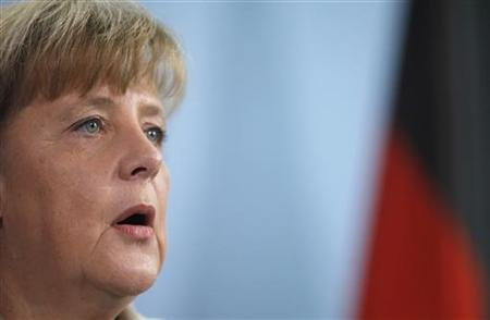 German Chancellor Angela Merkel makes a statement at the Chancellery in Berlin February 17, 2012, following the resignation of German President Christian Wulff earlier. German President Christian Wulff resigned on Friday after state prosecutors asked parliament on Thursday to remove his legal immunity over accusations that he accepted favours.   REUTERS/Thomas Peter