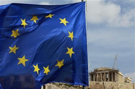A European Union flag is seen in front of the Parthenon temple in Athens February 21, 2012. Euro zone finance ministers sealed a 130-billion-euro ($172 billion) bailout for Greece on Tuesday to avert a chaotic default in March after persuading private bondholders to take greater losses and Athens to commit to deep cuts.  REUTERS/John Kolesidis  (GREECE - Tags: POLITICS BUSINESS RELIGION)