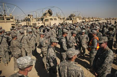 Soldiers from the 3rd Brigade Combat Team, 1st Cavalry Division smiles as they assemble at Camp Victory in Kuwait after traveling from Camp Adder in the last U.S. military convoy to leave Iraq December 18, 2011. REUTERS/Lucas Jackson