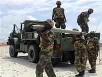 Ugandan soldiers from the African Union (AU) unload a rocket casing recovered on a patrol from their truck at Jaziira beach settlement in Mogadishu in a file photo. REUTERS/Shabelle Media