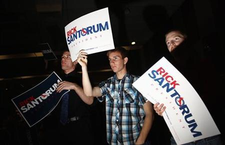 Supporters listen as Rick Santorum speaks during a campaign rally in Phoenix, Arizona February 21, 2012. REUTERS/Joshua Lott