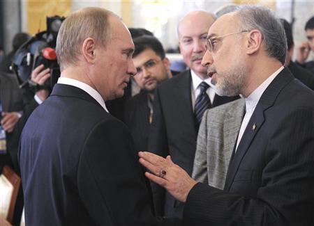 Russian Prime Minister Vladimir Putin (L) speak to Iran's Foreign Minister Ali Akbar Salehi during a meeting of the Shanghai Cooperation Organisation in St. Petersburg November 7, 2011. REUTERS/Alexsey Druginyn/RIA Novosti/Pool