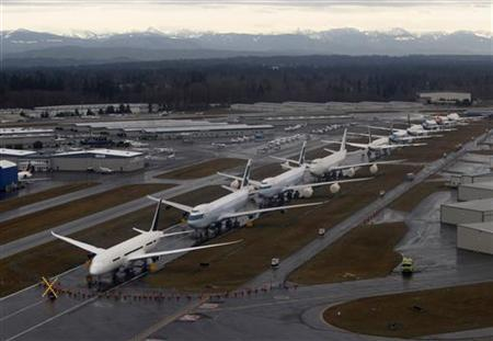 A line-up of Boeing 747s and 787 Dreamliners are pictured at the Boeing production facility in Everett, Washington February 17, 2012.  REUTERS/Jason Reed