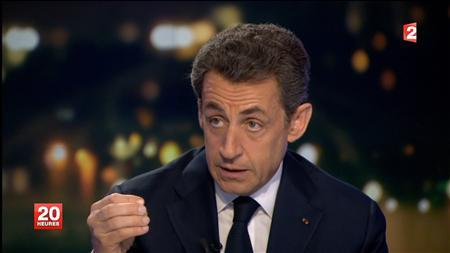 Nicolas Sarkozy, France's President and the UMP candidate for the 2012 presidential election, is seen in this video grab in an interview on France 2 Television during the prime time evening news programme at their studios in Paris February 22, 2012.   REUTERS/France 2 Television/Handout