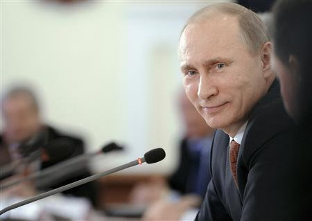 Russian Prime Minister Vladimir Putin smiles during a meeting with business owners from the Altai region, in the city of Barnaul February 21, 2012.   REUTERS/Alexsey Druginyn/RIA Novosti/Pool