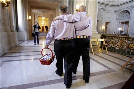 Two men walk inside San Francisco City Hall as they prepare to get married on the first full day of legal same-sex marriage in California June 17, 2008.  REUTERS/Erin Siegal