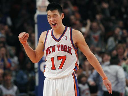New York Knicks point guard Jeremy Lin reacts in the fourth quarter against the Dallas Mavericks during their NBA basketball game at Madison Square Garden in New York, February 19, 2012. REUTERS/Adam Hunger