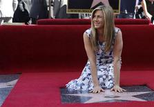 Actress Jennifer Aniston touches her star after it was unveiled on the Walk of Fame in Hollywood, California February 22, 2012. REUTERS/Mario Anzuoni