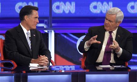 Republican presidential candidate former Massachusetts Governor Mitt Romney listens as former Speaker of the House Newt Gingrich (R) speaks during the Republican presidential candidates debate in Mesa, Arizona, February 22, 2012.  REUTERS/Joshua Lott