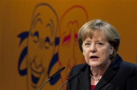 German Chancellor Angela Merkel delivers a speech during a Political Ash Wednesday meeting of the Christian Democratic Union (CDU) in the northern town of Demmin, February 22, 2012.  REUTERS/Thomas Peter (GERMANY - Tags: POLITICS RELIGION)