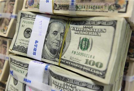 Stacks of U.S. 100 dollar notes at the Korea Exchange Bank in Seoul August 2, 2011. REUTERS/Jo Yong-Hak