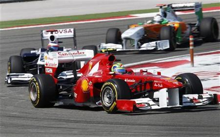 Ferrari Formula One driver Felipe Massa of Brazil (R) drives ahead of Williams Formula One driver Rubens Barrichello of Brazil (L) and Force India Formula One driver Adrian Sutil of Germany during the Turkish F1 Grand Prix at the Istanbul Park circuit in Istanbul May 8, 2011. REUTERS/Umit Bektas