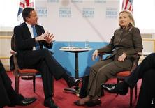 U.S. Secretary of State Hillary Clinton (R) meets with British Prime Minister David Cameron during a conference on ending two decades of anarchy in Somalia, in London February 23, 2012.  REUTERS/Jason Reed