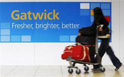 A passenger arrives at the South Terminal of Gatwick Airport in southern England October 21, 2009. REUTERS/Luke MacGregor