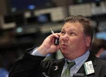A trader reacts while working on the floor of the New York Stock Exchange (NYSE) September 12, 2011.