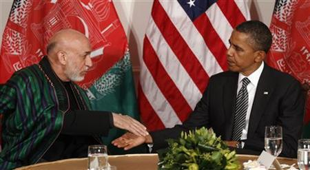 U.S. President Barack Obama (R) shakes hands with Afghanistan President Hamid Karzai in New York September 20, 2011. REUTERS/Kevin Lamarque/Files