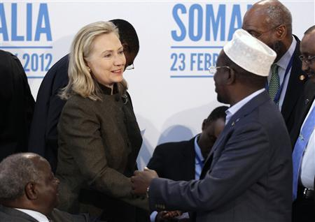 Secretary of State Hillary Clinton (L) shakes hands with the President of Somalia, Sheikh Sharif Ahmed, during the London Conference on Somalia at Lancaster House in London February 23, 2012.    REUTERS/Matt Dunham/pool