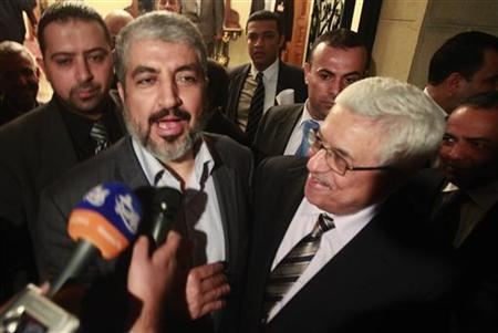 Hamas leader Khaled Meshaal and Palestinian President Mahmoud Abbas speak to the media after their meeting in Cairo, February 22, 2012. REUTER/Asmaa Waguih