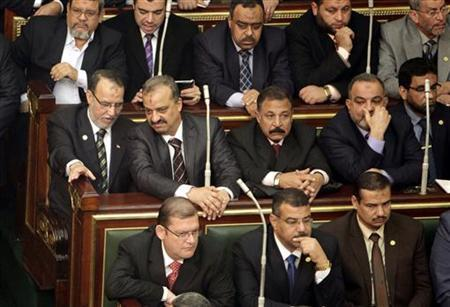 Essam el-Erian , (1st L) on second row, vice chairman of the Freedom And Justice party, and Muslim Brotherhood member Mohamed El-Beltagy (R) attend the first Egyptian parliament session after the revolution that ousted former President Hosni Mubarak in Cairo, January 23, 2012. REUTERS/Asmaa Waguih