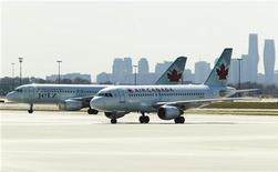 Air Canada aircrafts are seen at Toronto Pearson International Airport, September 20, 2011.    REUTERS/Mark Blinch